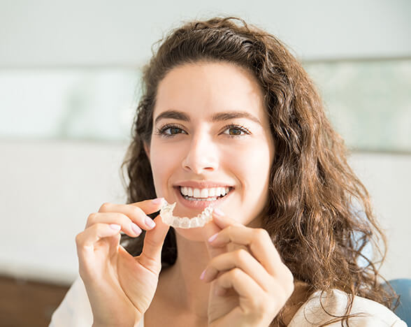 woman inserting her ClearCorrect aligners