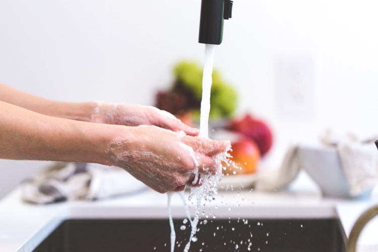Person washing their hands using proper hand washing technique to prevent coronavirus
