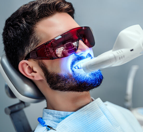 man receiving ZOOM whitening treatment